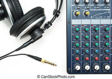 Mixing console and headphones. Element of music design.