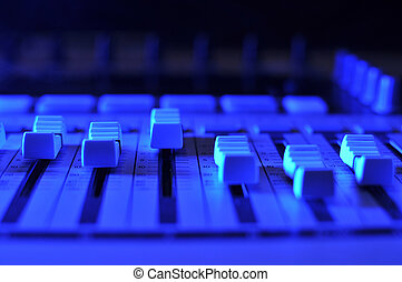 Mixing console illuminated by blue light