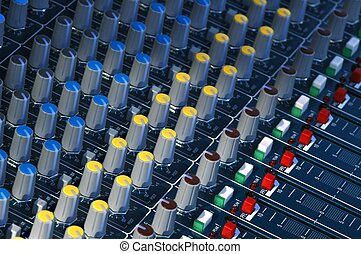 Mixing Console - Mixing console dials, buttons and faders.