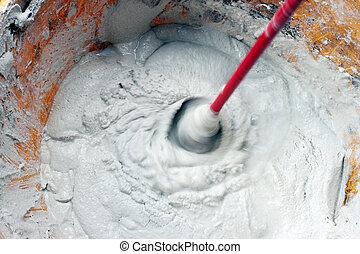 mixing glue or cement - detail of a mixer mixing cement or ...