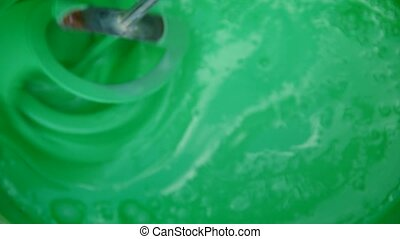 Mixing green color with a drill
