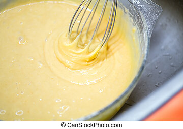 mixing homemade cake
