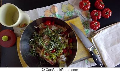 Mixing Ingredients For Pork Ribs Marinade - Woman mixing in...