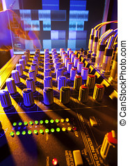Mixing Music - Close-up of an audio mixing desk with...
