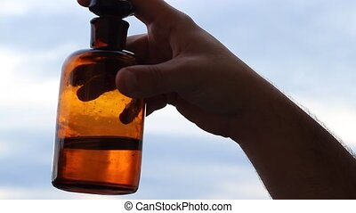 Mixing Potion in Ancient Bottle - Old mysterious liquid, on...