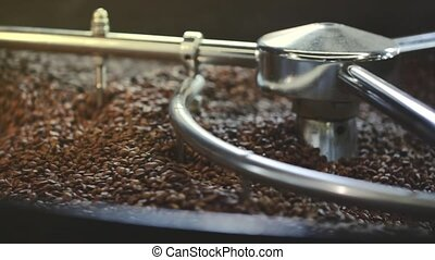 Mixing roasted coffee - roasted coffee beans in the machine