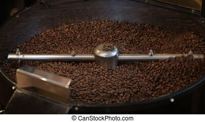 traditional coffee roaster cooling off fresh roasted coffee beans
