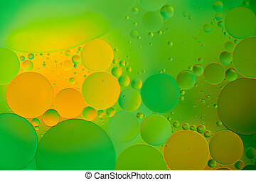 Mixing water and oil, beautiful color abstract background based on red and yellow circles and ovals, macro abstraction