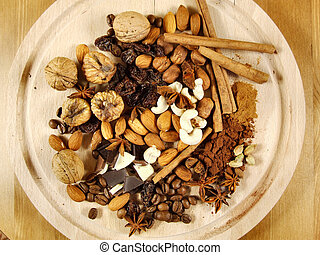 Mixture of nuts and dried fruit with coffee beans and other stuff. Christmas cuisine concept.