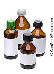 Liquid medicine in glass bottle on white background