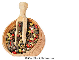 Mixture of allspice in a wooden cup isolated on white background. Free space for text.