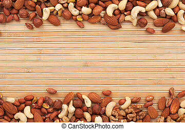 Mixture of nuts lying on a bamboo mat