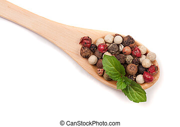 Mixture of peppers hot, red, black, white and green pepper in a wooden spoon isolated on white background. Top view