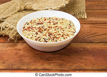 Mixture of the uncooked different rice in a white dish