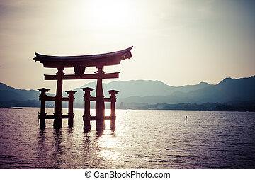 Miyajima, Famous big Shinto torii standing in the ocean in...