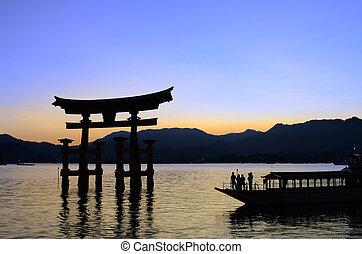Miyajima Gate in Japan - The large Otori during high tide at...