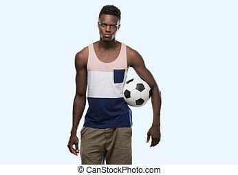 mládě, afričan američanka voják, majetek, fotbal football, koule, s, jeden, sebejistý, vyjádření, dále, bystrý, čelit, myslící, opravdový