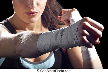 MMA Fighter Punch - female MMA fighter punching. black...