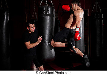 MMA Fighter training at a gym - Latin Fighter throwing a...