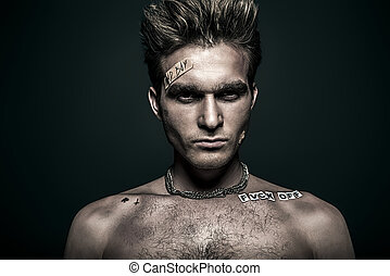 MMA male fighter - Bad boy concept. Close-up portrait of a...