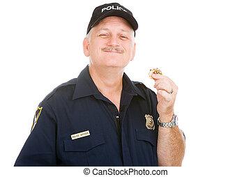 Mmmmm Tasty Donut - Police officer enjoys finishing off a...