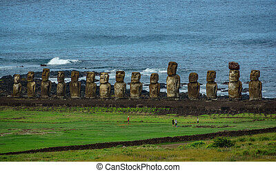Moai statues on Easter Island with tourists from the...