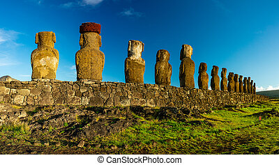 Moai statues rear view on Easter Island. Ahu Tongariki -...