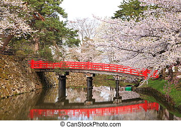 Moat and red bridge of Hirosaki castle, Aomori, Japan