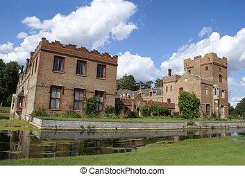 moated ornate Tudor architecture
