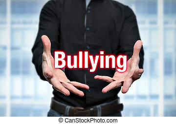 Mobbing, bullying, man holds lettering in the hands