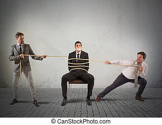 Mobbing colleague - Businessmen hold tied one of their...