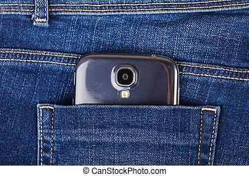 mobiele telefoon, spijkerbroek
