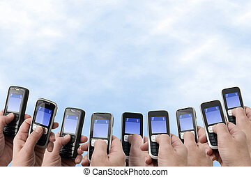 Mobil Phones - Hands and Phones - Many hands holding mobile...