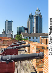 Mobile, Alabama, USA cityscape and fort.