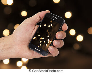 mobile and hand with christmas background