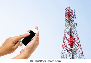 mobile antenna tower against blue sky background