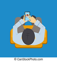 Mobile app - View from overhead of a man sitting in a chair...
