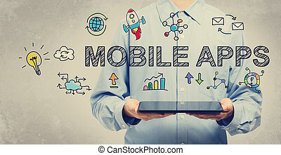 Mobile Apps concept with young man holding a tablet