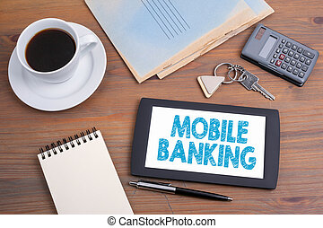 Mobile banking, business concept. Text on tablet device on a wooden table