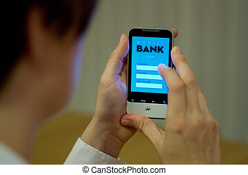 Mobile banking - Female smartphone user accessing mobile...