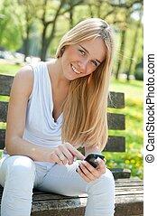 Mobile communication - smiling teenager