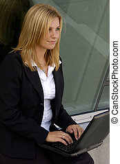 Mobile Computing - Attractive Blond Businesswoman using a...