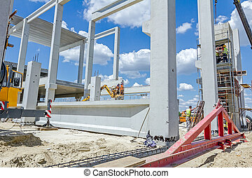 Mobile crane is carry concrete joist to assembly huge hall