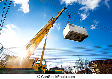 Mobile crane operating by lifting and moving an heavy...