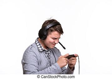 mobile, cuffie, telefono, giocando gioco, telefono., adolescente, gioco, dipendenza, tipo, scolaro
