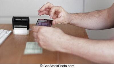 Mobile deposit of check using bank app on smartphone - Man...