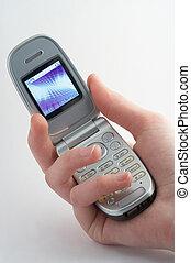cell phone with shiny display in a girls hand on white background - Handy mit beleuchtetem Display in Frauenhand vor weissem Hintergrund