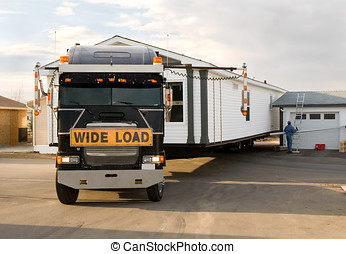 Mobile Home Installation - Semi-Truck backing in a mobile...
