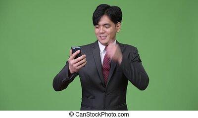 mobile, jeune, téléphone, asiatique, utilisation, homme affaires, beau