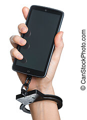 Mobile phone addiction concept. Smartphone and handcuff in...